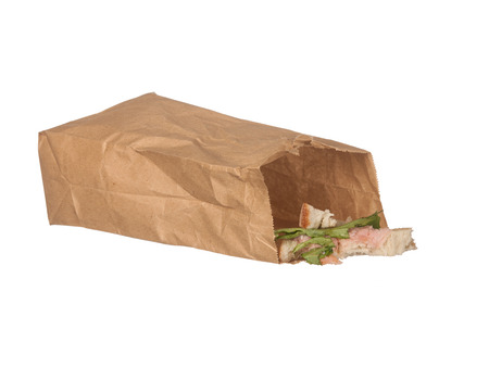 leftovers: Sandwich left-overs in brown paper bag isolated on white backbround