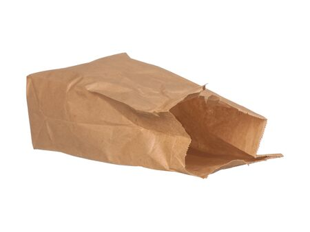Open brown paper bag laying down isolated on white background