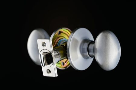 complete: Complete door knob mechanism isolated on black background