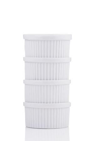 unsound: White ramekin dishes stable stack isolated on white background