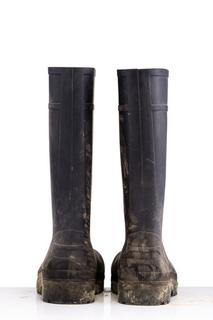 masculin: Dry dirty Mud boots isolated on pure white background back view