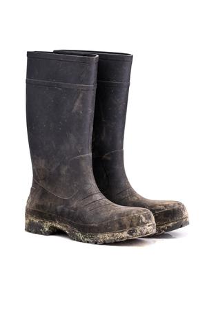 Bottes de boue sale sec isolés sur fond blanc pur vue 3/4 Banque d'images - 67032932