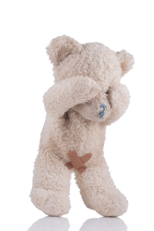 Toy bear with adhesive bandages on his private parts 34 view