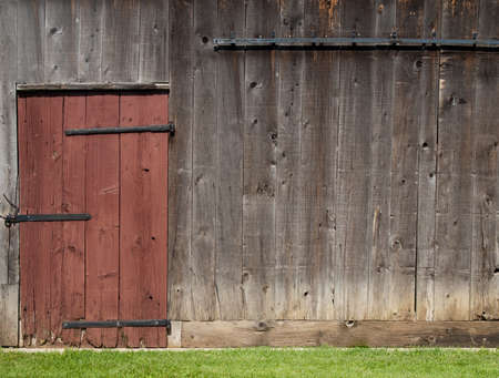 Old barn wall with red door