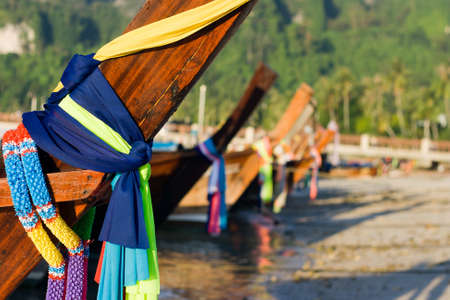 Colorful Ribbons of long tail boats Stock Photo