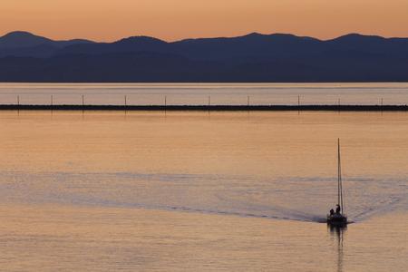 Sailboat in Port Angeles WA Harbor at Sunset