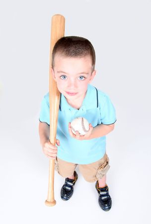 Young boy holding a baseball bat and ball on white background Stock Photo