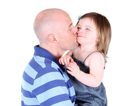 Handsome father kissing toddler daughter on the cheek Stock Photo - 7623092