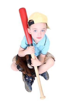Young preschool boy holding bat in studio on white background