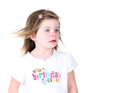 wind blown hair: Toddler girl with wind blown hair isolated on white background Stock Photo