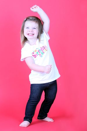 infants: Pretty Toddler Girl Dancing on a pink background