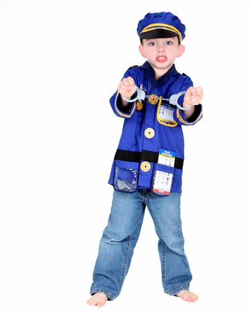 Young boy in police costume with handcuffs on white background photo