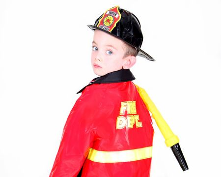 Young boy in fireman costume on white background Stock Photo