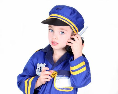 Young boy in police costume with hand radio Stock Photo