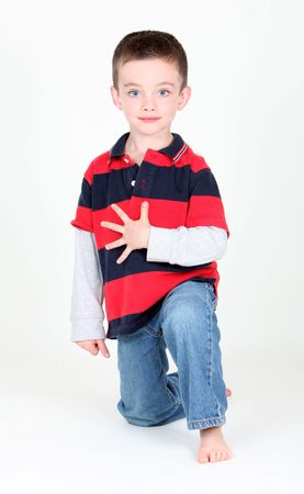 Preschool boy holding up 5 fingers for his age on white background