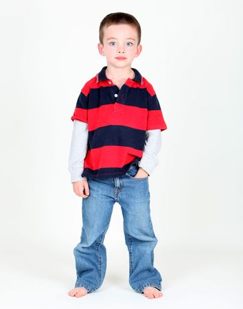 Young boy posing with hand in pocket on white background Stock Photo