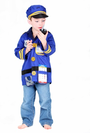 Young Preschool boy in Police costume isolated on white background Stock Photo