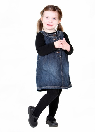 knees bent: Cute toddler girl with hands folded on white background
