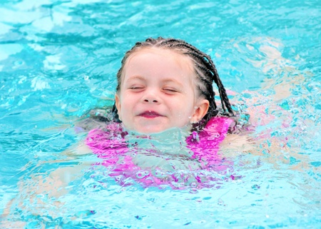 lifejacket: Young child swimming in pool with lifejacket