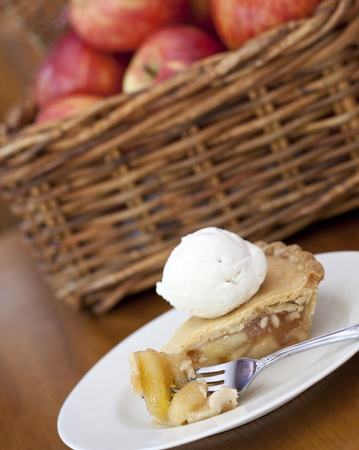 Apple pie ala mode on a wooden table