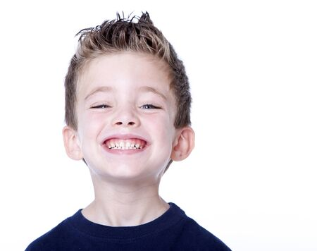 toothy smile: Happy young boy with smile on his face on white