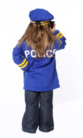 police girl: Young girl in police costume from behind