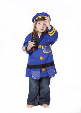 Little Girl in Police Costume Isolated on White Banco de Imagens