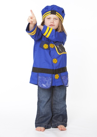 kids dress: Young girl in police costume pointing her finger