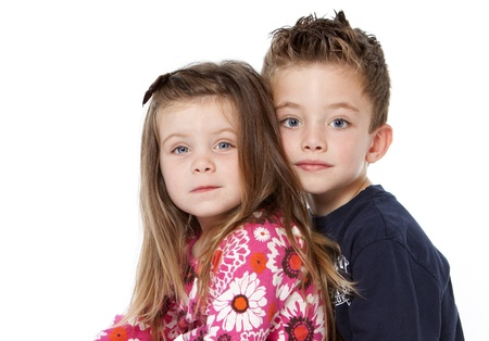 Siblings portrait isolated on a white background Banco de Imagens