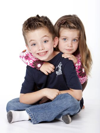 brothers and sisters: Siblings portrait isolated on a white background Stock Photo