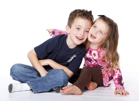 silliness: Siblings portrait isolated on a white background Stock Photo