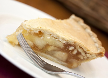 Slice of apple pie with a fork Stock Photo