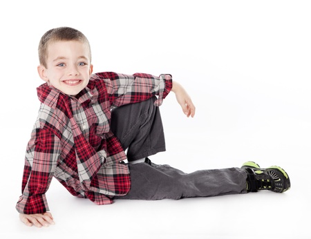 Young boy in plaid shirt laying on his side in studio Stock Photo - 11385117