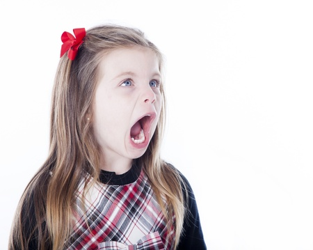 Young girl isolated on white with her mouth open looking to side photo