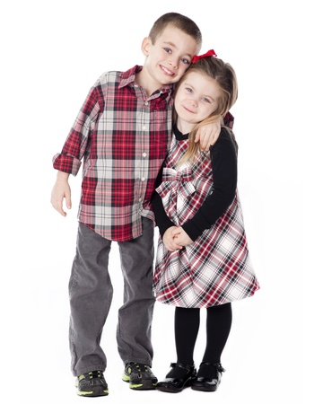 dressy: Boy and Girl embracing in dressy clothes in studio isolated on white Stock Photo