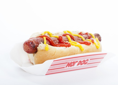 hot dog: A hot dog with mustard and ketchup isolated on white Stock Photo