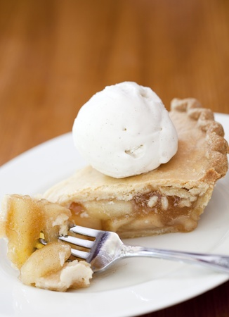 Apple pie alamode on a wooden table