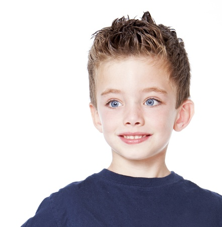 Young boy portrait in studio isolated on white. Stock Photo