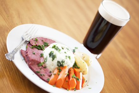 Traditional Corned Beef Dinner with Beer on a table Stock Photo