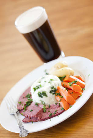saint patty's: Traditional Corned Beef Dinner with Beer on a table Stock Photo