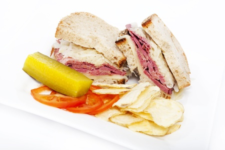 st patty day: Corned beef reuben sandwich on white background