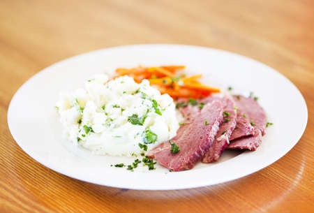 st patty day: Corned been and colcannon potato dinner on a wooden table