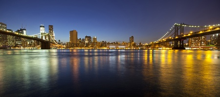 VIew of Manhattan and Brooklyn bridges and skyline at night Stock Photo - 13533282