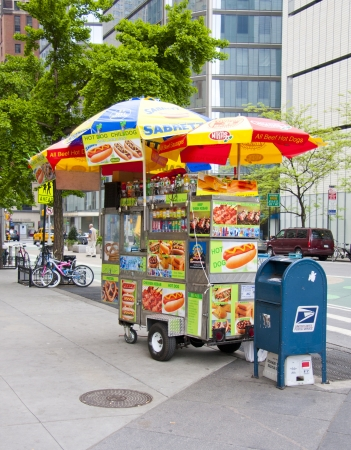 NEW YORK CITY USA-MAY 6 2012: Midtown, Hot dog vendors are a staple on the streets in New York City, May 6th, 2012 in Manhattan, New York City  Stock Photo - 13669545