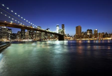 lower manhattan: Brooklyn bridge and skyline at night