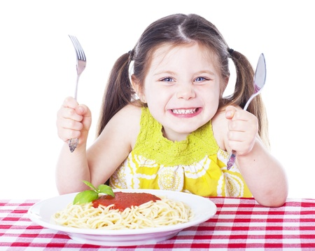 eating pasta: Beautiful girl eating pasta isolated on white Stock Photo