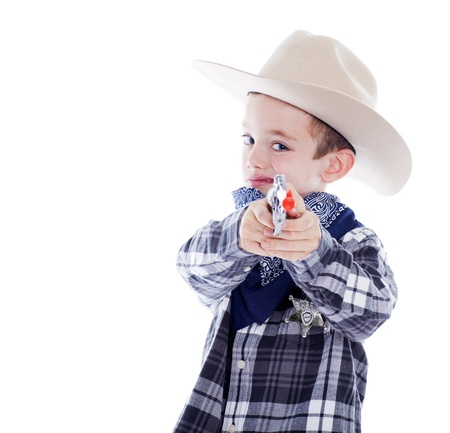 dressup: Young boy dressed as a cowboy with gun