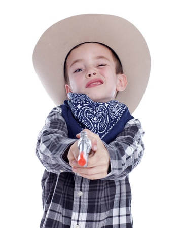 Young boy dressed as a cowboy with gun