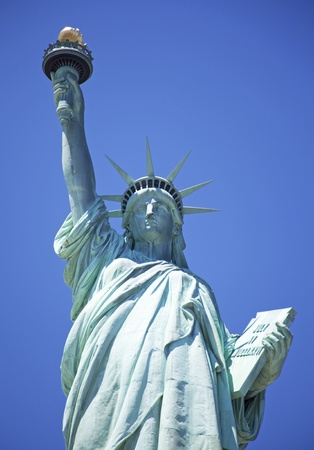Statue of Liberty with blue sky photo