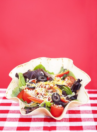 Taco salad on checkered tablecloth